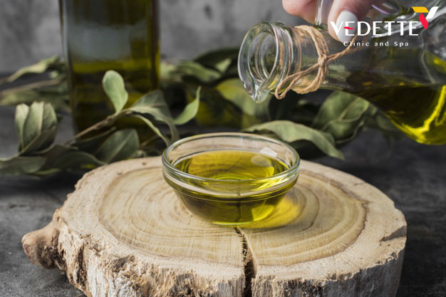 close up olive oil pouring into bowl 23 2148364511