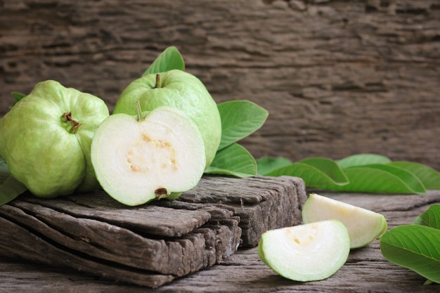 fresh guava with green leaves wooden background 184421 330